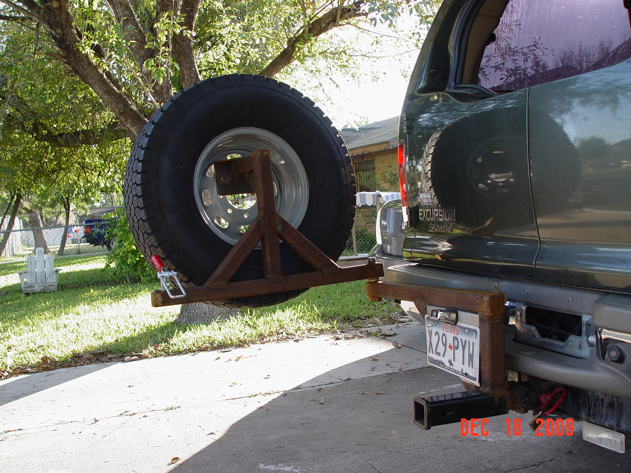 Ford excursion swinging spare tire carrier interesting