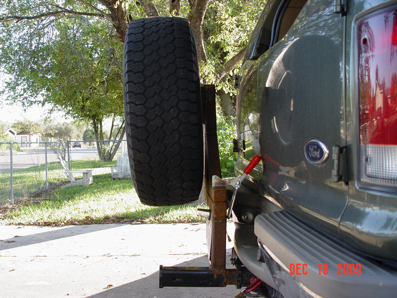 Ford excursion swinging spare tire carrier properties leaves
