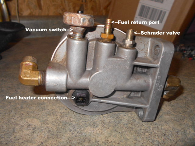 Image of a generic filterhead from DieselStop, which shows a typical Schroeder Valve on the right.