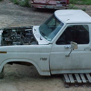 The cab and front clip off the frame and on blocks.