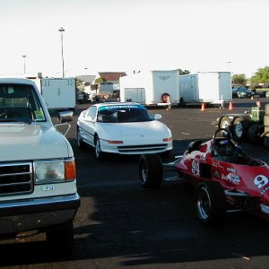 1990 F150 with car in Paddock