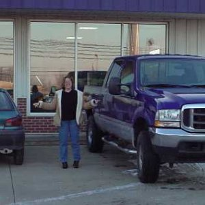 Wife with her Geo Metro, and new F250
