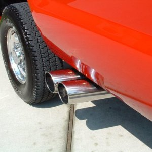 "Dual 5"" tips in front of rear tire"